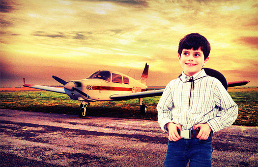 Child wearing a fashionnable aircraft seat belt in front of a plane